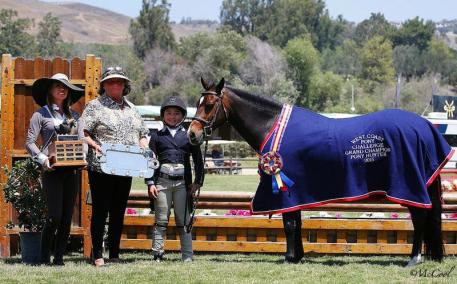 Overall Grand Champion Pony Somekindawonderful and Augusta Iwasaki (Photo: McCall)