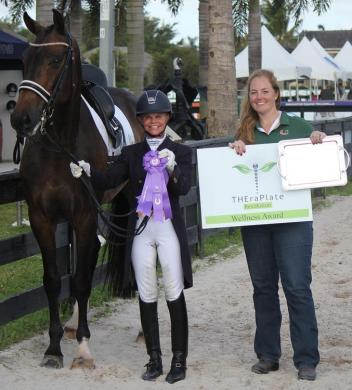 Something Special C and Adrienne Pot (left) wins the TheraPlate Award at the Adequan Global Dressage Festival