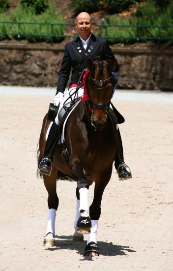 Steffen Peters during a victory lap at the 2012 US Dressage Festival of Champions