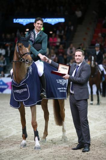 Olympic champion, Switzerland's Steve Guerdat, pictured with Casper Gebeke, Longines Sweden country manager, after winning the twelfth and final qualifying round of the Longines FEI World Cup™ Jumping 2014/2015 Western European League with the mare Albfuehren's Paille at Gothenburg, Sweden today. (FEI/Roland Thunholm)