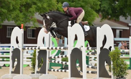 Taylor Flury piloted Iconic Bay Equestrian's Jett B to the win in the Six-Year-Old Jumpers at the Devon Horse Show. (Photo: The Book LLC)