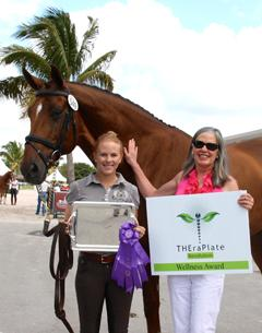 Rider Mary Rollins (left) and owner Teresa Simmons (right) stand with their TheraPlate Award winner Royal Prinz at the Adequan Global Dressage Festival