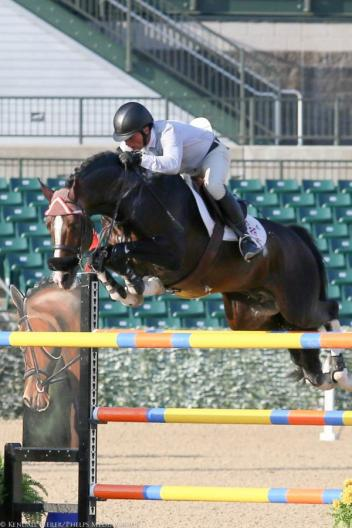 Todd Minikus and Con Capilot won the 1.45m Open Jumpers on the first day of the Kentucky Spring Horse Show.