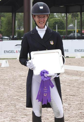 """Arlene """"Tuny"""" Page accepts the TherPlate Award for the excellent fitness of her own Alina at the 2015 Adequan Global Dressage Festival"""