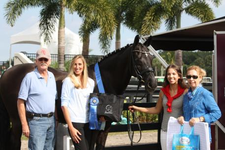 Doug and Michele Hundt of ShowChic and Krystalann Shingler of ShowChic present Chase Hickok and Sagacious HF with the first ShowChic Turnout Award of the 2015 AGDF (left to right: Doug Hundt, Krystalann Shingler, Chase Hickok, and Michele Hundt)