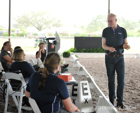Kjell Myhre talks to riders at the 2015 USEF High Performance Southeast Para Equestrian Dressage Symposium in Wellington, FL, January 12-13. (Photo: (C) Lindsay Y. McCall)