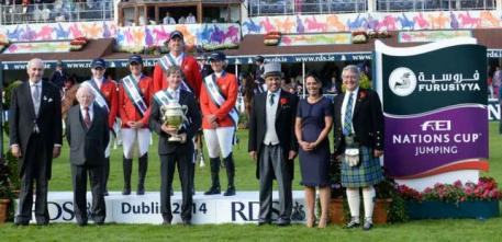 Team USA won their third consecutive Furusiyya FEI Nations Cup™ Jumping competition at the last leg of the Europe Division 1 2014 series in Dublin, Ireland today.  Pictured (L to R): Matt Dempsey, President of the Royal Dublin Society: His Excellency the President Of Ireland Micheal D Higgins: Katie Dinan, Jessica Springsteen, Charlie Jayne, Chef d'Equipe Robert Ridland and Beezie Madden from Team USA; Saudi Arabian Ambassador to Ireland His Excellency Abdul Aziz Abdul Rahman Aldriss: Katrina Jones, Brand D