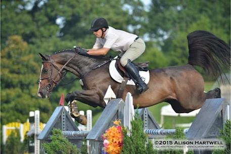 Vale and Quidam's Good Luck fly over an oxer on their way to the win in the 5,000 Nalley Toyota Stonecrest Open Welcome Week II at the Atlanta Summer Classics. (Photo: Allison Hartwell)