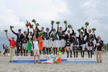 Enjoying their well-earned moment of glory on the podium at the FEI European Eventing Championships for Young Riders 2014 in Vale Sabroso, Portugal were the medal-winning teams from (L to R) Germany (silver), Ireland (gold) and Great Britain (bronze). (FEI/Nuno Goncalves)