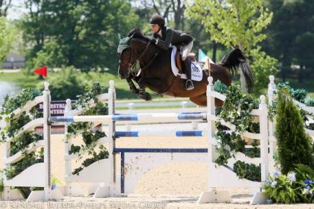 Vivian Yowan and Vornado van den Hoendrik win the High Amateur-Owner/Junior Jumpers at the Kentucky Spring Horse Show.