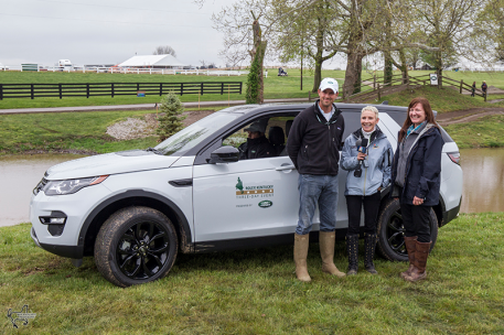Will Coleman (left) won the Land Rover Best Ride of the Day Award, presented by Kim McCullough, vice president of marketing for Jaguar Land Rover North America (right). Television personality Donna Brothers hosted the presentation. (Photo: Ben Radvanyi)