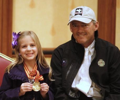 Will Simpson shares a Gold Medal moment with a young fan. Photos by EqSol and Captured Moment Photo.