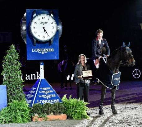 Great Britain's William Whitaker pictured with Longines representative Christiane Becherer after his victory with Fandango in today's Longines FEI World Cup™ Jumping 2014/2015 Western European League qualifier at Stuttgart, Germany. (FEI/Karl-Heinz Freiler)