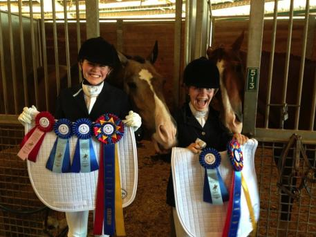 Dressage4Kids competitors with their winning ribbons and Custom saddlepads