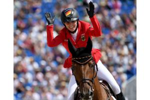 Germany's Simone Blum celebrates winning the Individual Jumping title at the FEI World Equestrian Games™ 2018 with DSP Alice and carving her name into the pages of equestrian history. (FEI/Martin Dokoupil)