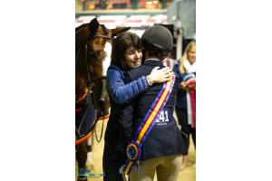 "Jessica Stone gets a hug from her mom after winning the USHJA 3'3"" Jumping Seat Medal Final."