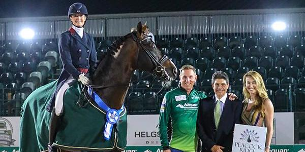 Charlotte Jorst in her winning presentation with Allyn Mann of Adequan®, Judge at C, Cesar Torrente, and P.J. Rizvi of Peacock Ridge. ©SusanStickle.com_.jpg