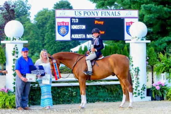 Augusta Iwasaki and Kingston claimed the Large Green Hunter Championship and Grand Green Pony Hunter Championship at the 2015 U.S. Pony Finals.