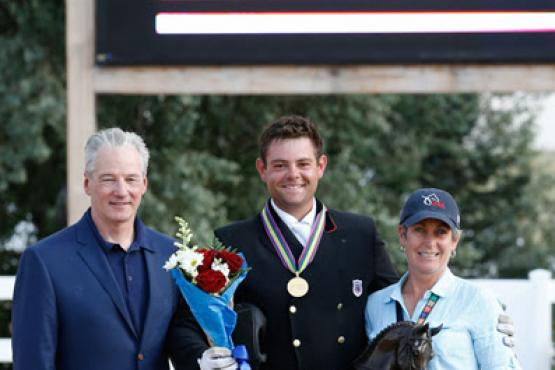 Stephan Hienzsch, USDF Executive Director; Nicholas Hansen, Region 1 Young Rider, recipient of the Fiona Baan Award; and Roberta Williams, USDF FEI Jr/YR Committee Chair.