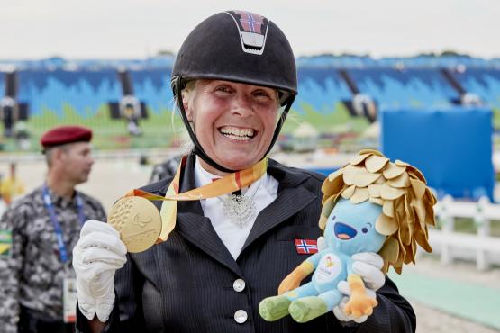 Norway's Ann Cathrin Lübbe wins the first Para-Equestrian medal at Rio 2016, taking gold in the Grade III Individual test on Donatello (Liz Gregg/FEI)