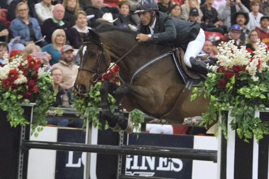 USA's Richard Spooner and Chatinus take flight as they claim victory in the Longines FEI World Cup™ Jumping Las Vegas (USA)