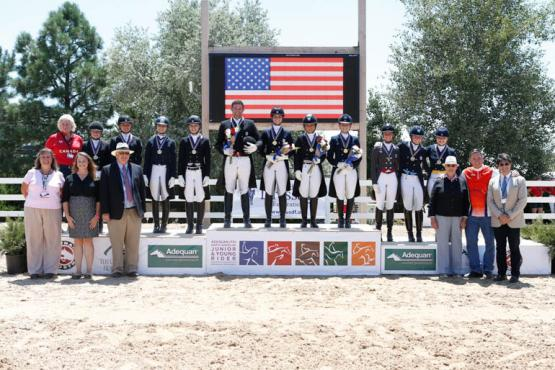 The medal presentation ceremony for the 2016 NAJYRC Dressage Young Rider Team Test featuring the Gold, Silver, and Bronze medal winning teams alongside Katherine Robertson, USDF Education Department Manager; Hannah Niebielski, USEF Director of Dressage National Programs; Michael Stone, President of The Colorado Horse Park; Leslie Steele, Chef d'Equipe of the Canadian Team; Jennie Loriston-Clarke, Foreign Technical Delegate; Allyn Mann of Adequan®; and judge Cesar Torrente (COL).