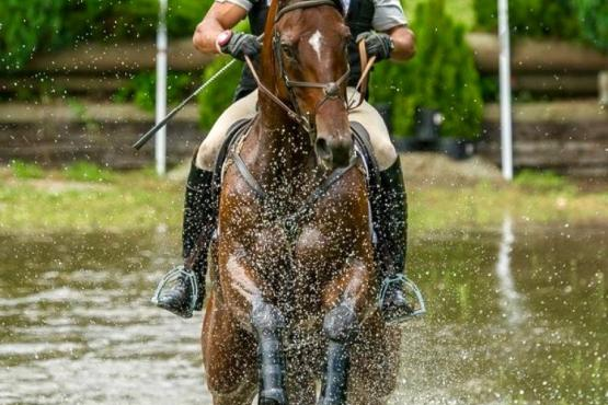 Kanyon Walker with his off-the-track Thoroughbred Kenneth Street making a splash going cross country (Photo: Shawn Tinkham Photography)