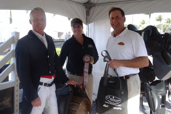 Jan Ebeling receiving the Custom Saddlery MVR Award with Frank Tobias during week five of the Adequan Global Dressage Festival