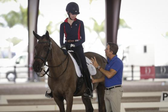 Robert Dover instructs Anna Wenniger during the 2019 Robert Dover Horsemastership Clinic Week