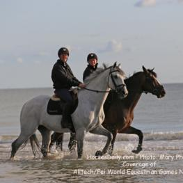Australian team showjumper Amy Graham and stable manager Jacqui Ridley take a walk on Utah Beach near their Normandy farm Haras Du Ry the morning of Openening Ceremonies