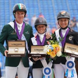Ros Canter, Padraig McCarthy, and Ingrid Klimke in their presentation ceremony.