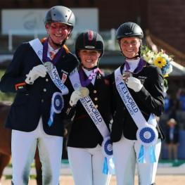 Sanne Voets, Rodolpho Riskalla, and Susanne Jensby Sunesen in their presentation ceremony for Grade IV Para Dressage. (Photo: ©Sportfot)