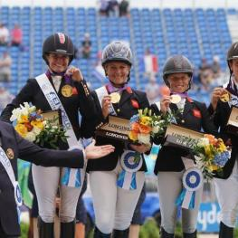 Piggy French, Gemma Tattersall, Ros Canter, and Tom McEwen with Chef d'Equipe Richard Waygood in their presentation ceremony.