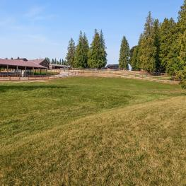 This 4.9 acre property has three barns, two outbuildings, three large turnouts, two arenas, and new fencing.