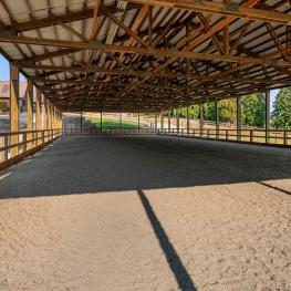 Enjoy riding and training in this amazing covered and lighted arena. It is 150 ft. x 50 ft., sand (no mud!), and features a brand new viewing area for equestrian competitions, a brand new retaining wall, and brand new gutters with fantastic drainage.