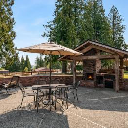 Just outside the great room and through two large sliders lies this immense outdoor patio with wood burning fireplace, wood burning stove, and grill. It is a fantastic place to entertain and enjoy the lovely views.