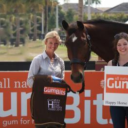 Laura Graves (left) and Verdades win the GumBits Happy Horse Harmony Award at the 2015 Adequan Global Dressage Festival