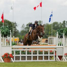 Ainsley Vince of Burlington, ON, and Magic Show, owned by Knightwood Stables, on their way to victory in the $10,000 Canadian Hunter Derby at the Ottawa International at Wesley Clover Parks on Sunday, June 21. (Photo: Ben Radvanyi Photography)