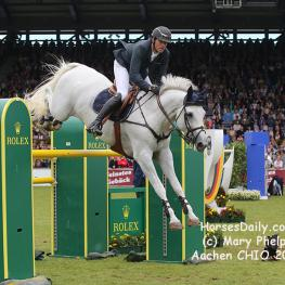 Gregory Wathelet (Bel) and Coree winners of the 2017 Grand Prix of Aachen with the Westfalen Mare \ Grey \ 2006 \ Cornet Obolensky x Liberty Life. Photo: (c) Mary Phelps