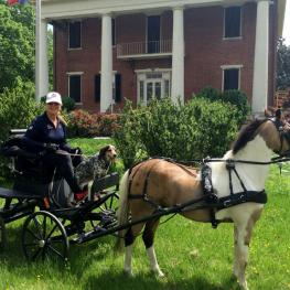 Mary Phelps and Al Capony in front of the plantation home