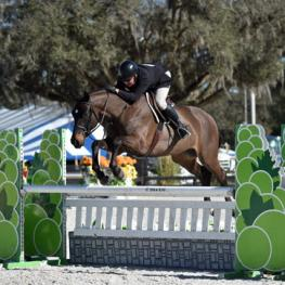Aaron Vale and Dress Balou on their way to a $10,000 Devoucoux Hunter Prix win. (Photo: ESI Photography)