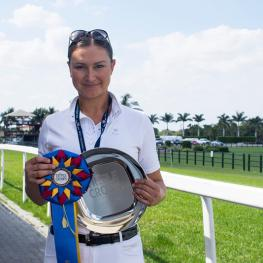 Adrienne Lyle receives the Triple Crown Nutrition Dressage Excellence Award during week eight of the Adequan Global Dressage Festival.
