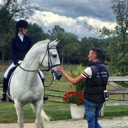 Stephen Hayes coaching one of his many young riders Anna Blazer.