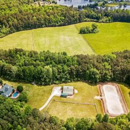 Welcome Home! Gorgeous 56.83 acre property to delight any equestrian's dream!
