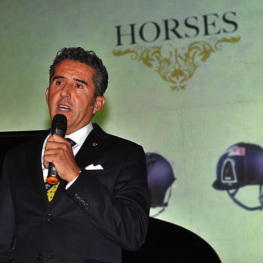 Dr. Cesar Parra speaks at the GK Horses ceremony in Florence, Italy