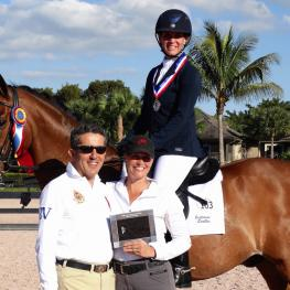 Charlene Moskowitz, with her trainer Denielle Gallagher-Legriffon (right), wins the Piaffe Performance Adult Amateur Achievement Award at the Adequan Global Dressage Festival, presented by Dr. Cesar Parra (left)
