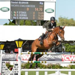 Daniel Bluman and Bacara d'Archonfosse won the $86,000 Douglas Elliman Grand Prix Qualifier at the Hampton Classic.