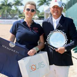 "David Raposa is presented with the ""Best Presented Horse"" Award and prizes from Manfredi Equestrian by Elena Couttenye of Equis Boutique during Week 6 at the Winter Equestrian Festival."