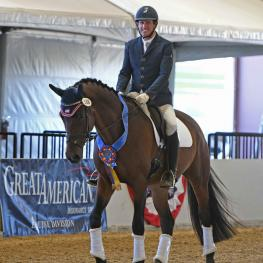 David Wightman of Murrieta, Cal. finally had a chance to smile after his five-year-old Oldenburg gelding Hotshot AF won the Great American/USDF Region 7 First Level Open Championship on an impressive score of 74.044%