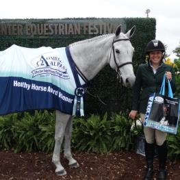 Elena Barrick and Silvermoon 36 win the Omega Alpha Healthy Horse Award during week five of the Winter Equestrian Festival